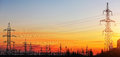 Electricity Pylons and Power Lines on sunset sky Royalty Free Stock Photo
