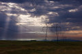 Electricity pylons at sunrise power lines in beautiful morning Stock Photo