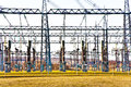 Electricity relay station with high-voltage insulator and power Royalty Free Stock Photo