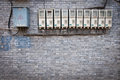 Electricity row of meters and fuse boxes in hutong area beijing china Royalty Free Stock Photo