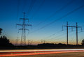 Electricity transmission power lines at sunset High voltage tower. Royalty Free Stock Photo