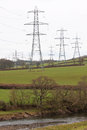 Electricty pylons in the UK countryside Royalty Free Stock Photo