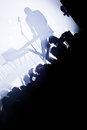 Electro concert and crowd music show with a dj mixing in silhouette Royalty Free Stock Images