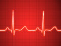 Electrocardiogram ecg graph pulse tracing on red Stock Photo