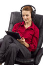 Electronic audio books woman listening to on a tablet Stock Images