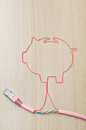 Electronic banking pink ethernet cable shaping a piggy bank Royalty Free Stock Photos