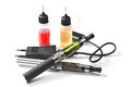 Electronic cigarettes e liquid bottles and charger Stock Photos