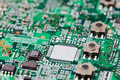 Electronic circuit board with components focused to middle down part of white Stock Photography