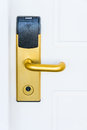 Electronic door lock white with an and handle of gold color Stock Image