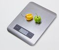 Electronic kitchen scales with peppers on the grey back Stock Image