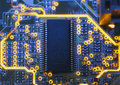 Electronic microcircuit and microchip close up Stock Photos