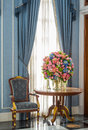 Elegance armchair and flower bouquet on table beautiful decoration Stock Photo