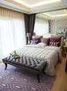 Elegance bedroom suite with purple color Stock Photos