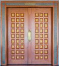 Elegance brown and golden color wood carving door Stock Photography