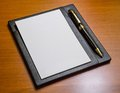 Elegance note paper luxury pen leather holder wood table Stock Photo