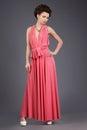 Elegance stylish brunette in pink festive dress elegant Stock Image
