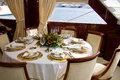 Elegance table in dining room yacht interior Stock Image