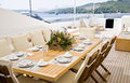 Elegance table outdoor summer day yacht deck with served Royalty Free Stock Photography