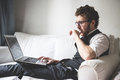 Elegant attractive fashion hipster man using notebook at home Royalty Free Stock Photography
