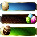Elegant banners with gold-decorated chocolate eggs Stock Images