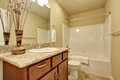 Elegant bathroom with an alcove tub and beige walls. Royalty Free Stock Photo