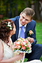 Elegant beautiful bride and groom in a meadow Stock Photo