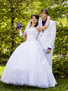 Elegant bride and groom posing together outdoors on a wedding day Royalty Free Stock Photography