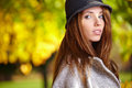 Elegant brunette woman in a park in autumn standing Stock Photography