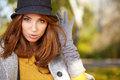 Elegant brunette woman in a park in autumn standing Stock Photos