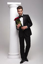 Elegant business man holding a bouquet of red roses Royalty Free Stock Photo