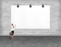 Elegant business woman looking at banner. Royalty Free Stock Photo