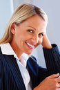 Elegant business woman smiling confidently Stock Photo