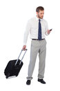 Elegant businessman with phone and suitcase Royalty Free Stock Photo