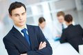 Elegant businessman portrait of young looking at camera in working environment Royalty Free Stock Photos