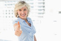 Elegant businesswoman gesturing thumbs up Royalty Free Stock Photo