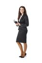 Elegant businesswoman with personal calendar smiling pretty standing handheld looking at camera Royalty Free Stock Images