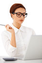 Elegant businesswoman reading her laptop Royalty Free Stock Image