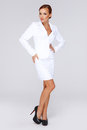 Elegant businesswoman in a white suit Stock Photo