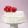 Elegant cake and sugar red roses on the top an white fondant with artisanal Royalty Free Stock Images