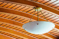 Elegant ceiling lamp close up in old wooden home Royalty Free Stock Image