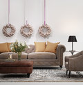 Elegant chic brown sofa with christmas bells wreath