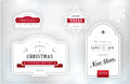 Elegant christmas labels emblems set of merry and happy new year and snowflakes in shades of gray silver white and red on textured Stock Images