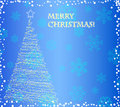 Elegant christmas tree on the blue background Royalty Free Stock Photos