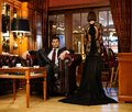 Elegant couple in formal dress in luxury cabinet Stock Image