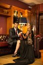 Elegant couple in luxury cabinet Royalty Free Stock Photo