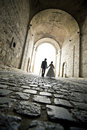 An elegant couple walk in the tunnel Royalty Free Stock Photo