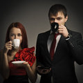 Elegant couples drinking coffee Stock Images
