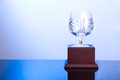 Elegant crystal cup trophy on blue hue ambient and classy Stock Images