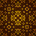 Elegant dark golden background made symmetrical decorative pattern Stock Photos