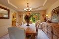 Elegant dining table set decorated with flowers luxury house elengant dinig Royalty Free Stock Image